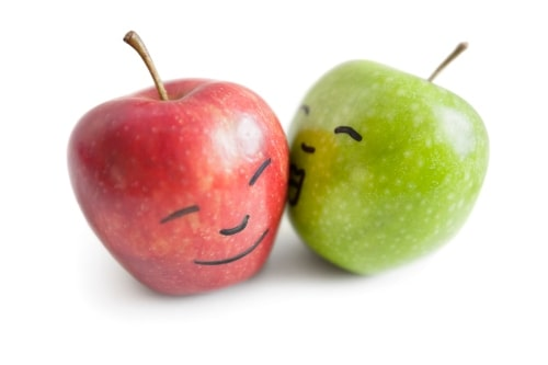 healthy fruit red and green apples with faces