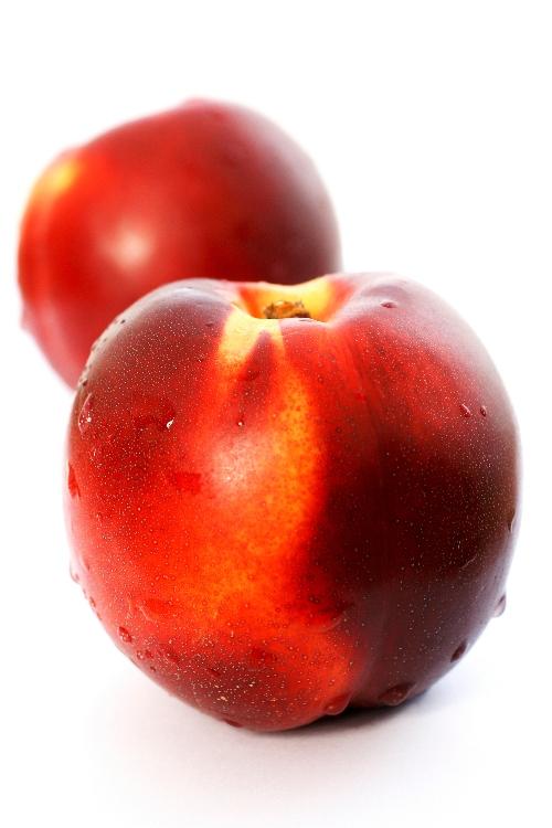 healthy fruit peaches on white background