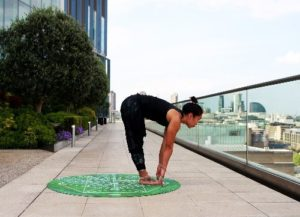 woman practicing yoga on rooftop