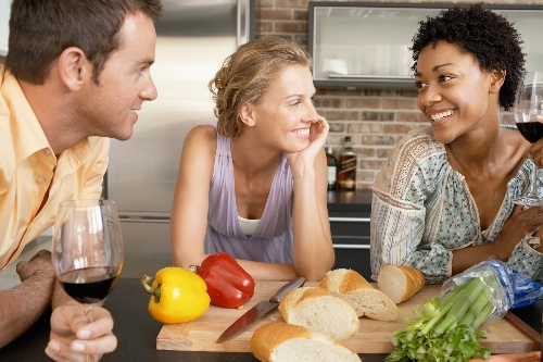 friends conversing while making dinner