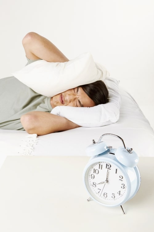 man not wanting to wake up from alarm