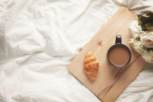 coffee and croissant in bed