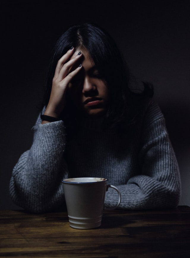 Woman in dark trying to let go of worrying