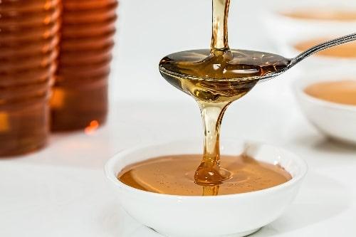 honey in white bowl