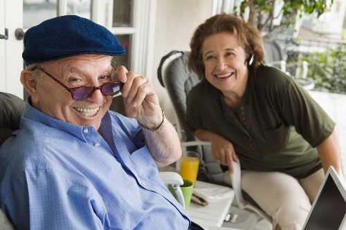 senior couple laughing on the porch