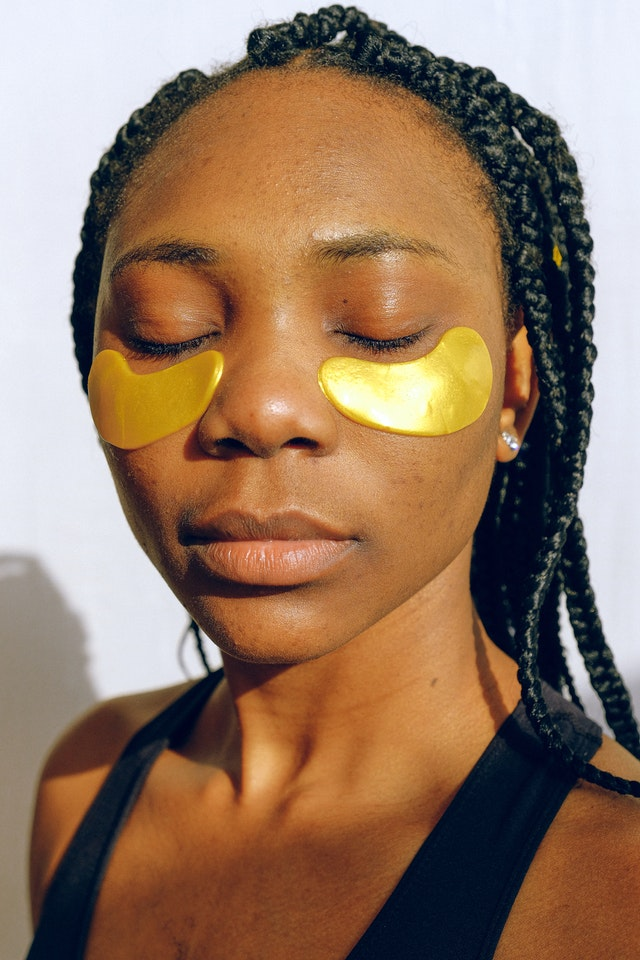 Woman trying on under eye face mask