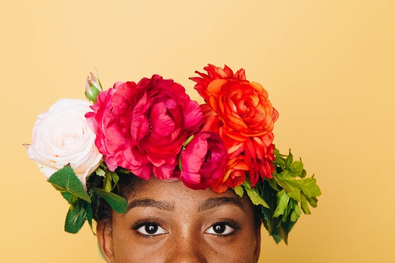 woman wearing crown of roses