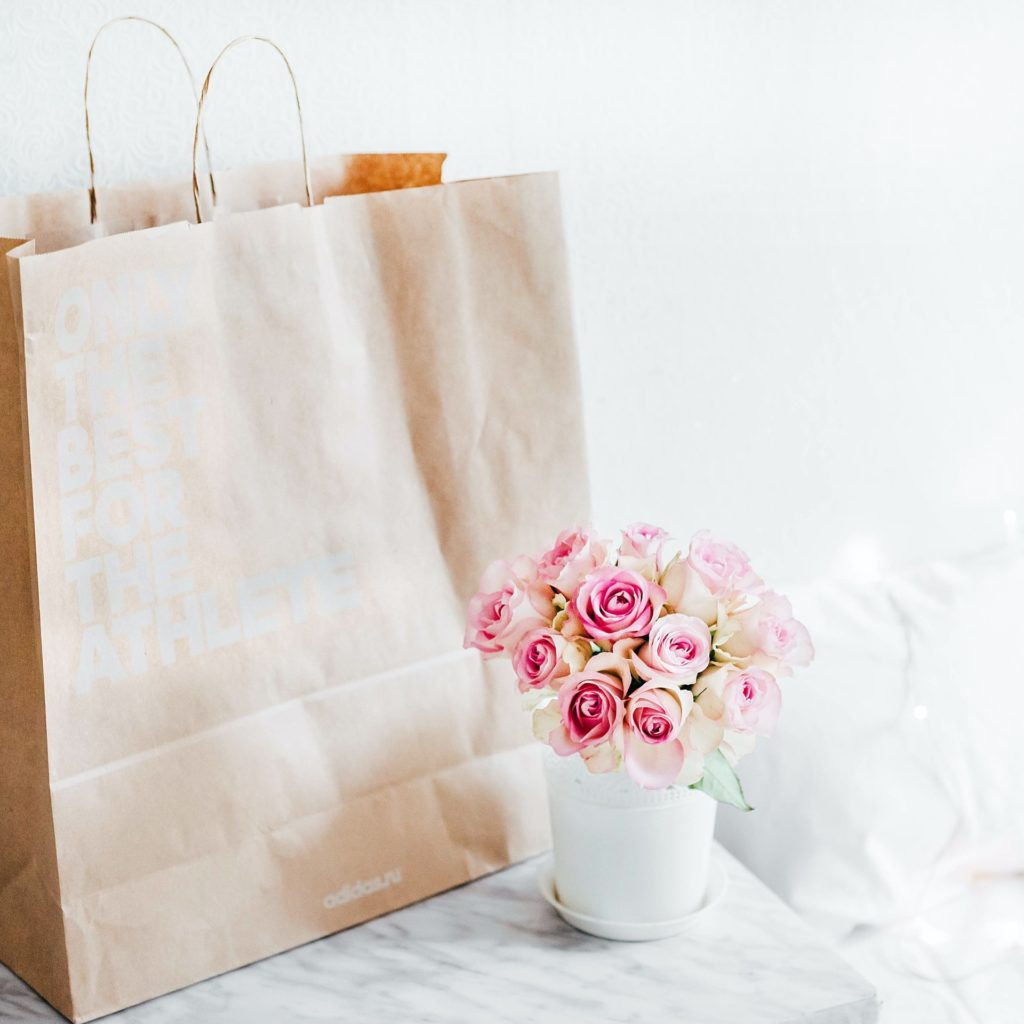 self care gifts for new moms pink roses and gift bag