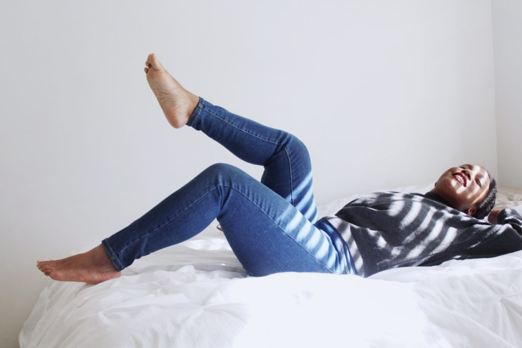 woman laying on bed relaxing