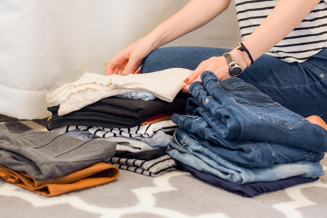Woman decluttering her clothes