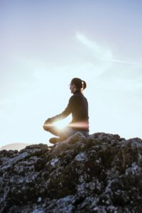 Woman practicing meditation tips for anxiety