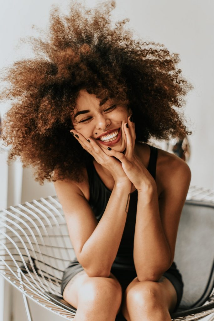 Woman who is very happy because she learned her favorite way to practice self care